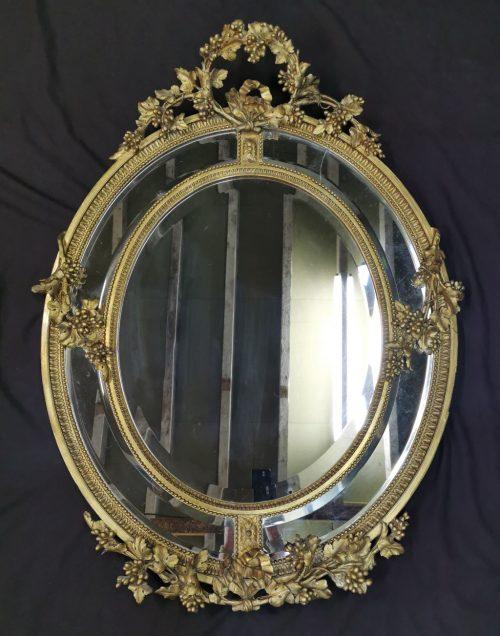 miroir ovale doré à parecloses antiquité napoléon